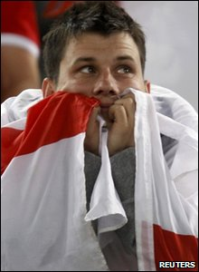 An England fan looking disappointed after England lose