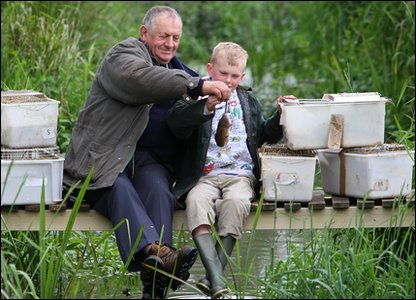 Jack and his Grandfather releasing the voles into the wild