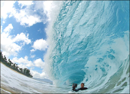 Clarke Little with his camera under a wave