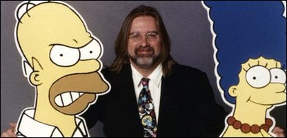 Creator Matt Groening with Homer and Marge Simpson