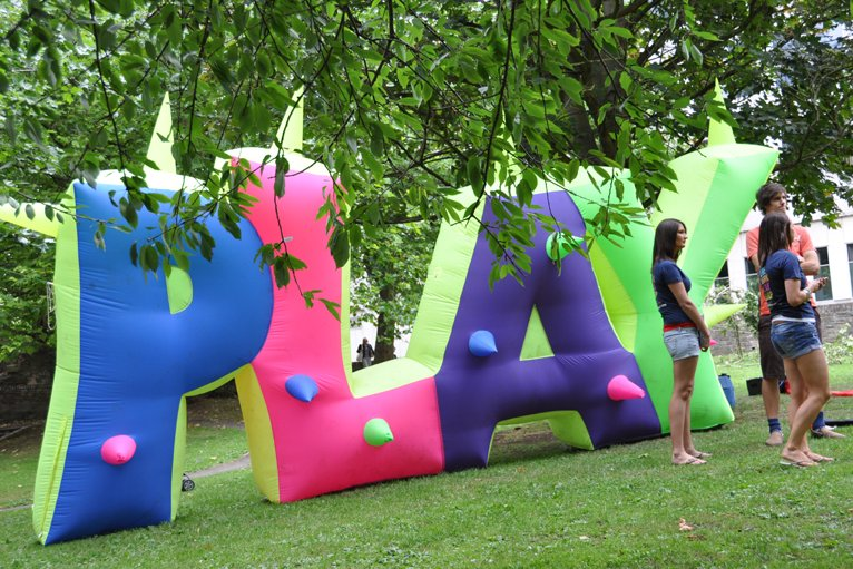 play splelled out in inflatable letters