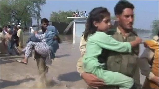 Kids being carried to safety in Pakistan floods
