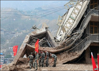 Collapsed buildings hit by landslides