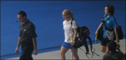 Sarah Milne walking out on court.
