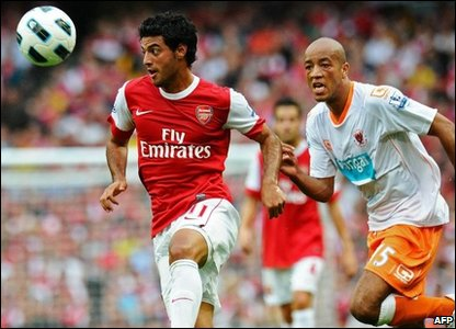 "Blackpool""s defender Alex Baptiste watches as Arsenal's striker Carlos Vela controls the ball"