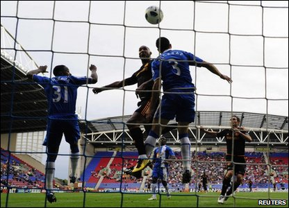 Chelsea's Nicolas Anelka heads to score against Wigan Athletic