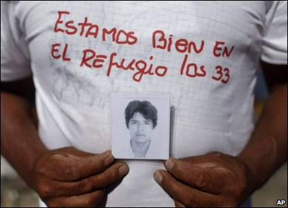 This is Alberto Segovia. He's holding a picture of his brother Dario, who is trapped in the mine.
