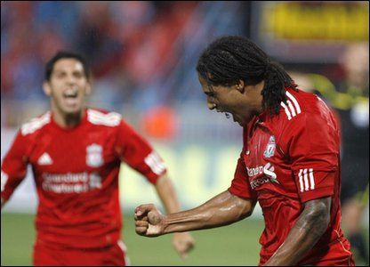 Glen Johnson celebrates Liverpool's first goal