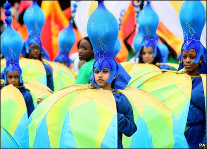 Notting Hill Carnival - kids in blue and yellow costumes