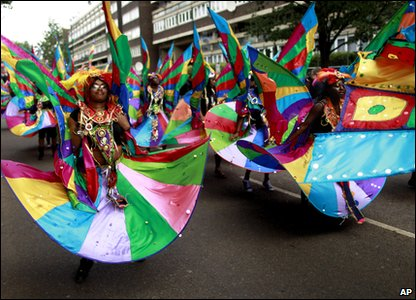 Notting Hill Carnival - people in rainbow costumes