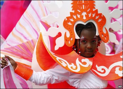 Notting Hill Carnival - girl in orange and white costume