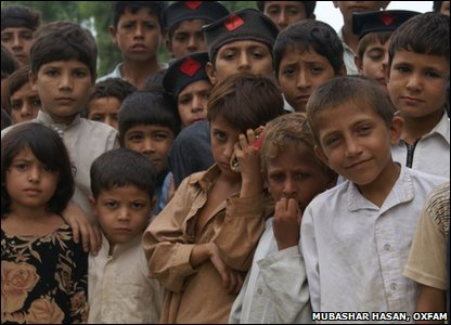 Pakistan kids outside their school which was badly damaged by the floods