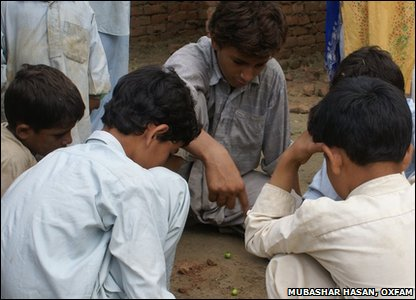 Pakistani kids play a game of adda kadda