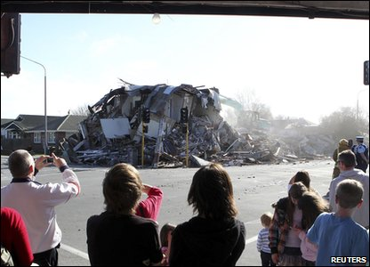 New Zealand earthquake - people take photos of a collapsed house