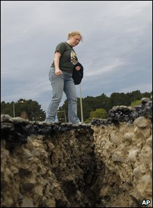 New Zealand earthquake - woman looks at big crack in road