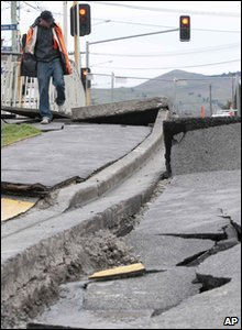 New Zealand earthquake - man checks out damaged road
