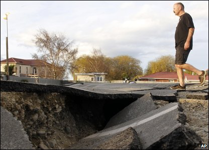 New Zealand earthquake - man walks along damaged road