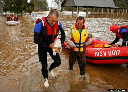 Stuart White and his dog Gypsy are evacuated by boat from their home in Wangaratta, Australia