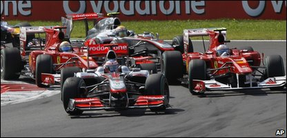 Lewis Hamilton is led by Fernando Alonso and Felipe Massa
