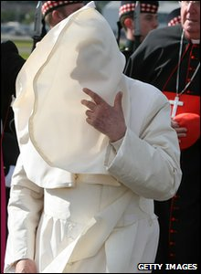 Pope is caught by a gust of wind at Edinburgh Airport