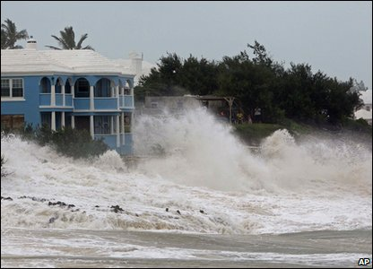 Waves crash against buildings as Hurricane Igor hits Bermuda