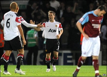 Manchester United's Michael Owen celebrates after scoring his side's third goal of the game during the third round Carling Cup match at Glanford Park, Scunthorpe