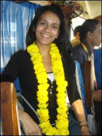 Sonali wearing the garland she was given at the airport