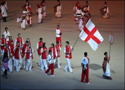 All the athletes take it in turns to walk around the stadium. England athletes' are led by flagbearer Nathan Robertson.