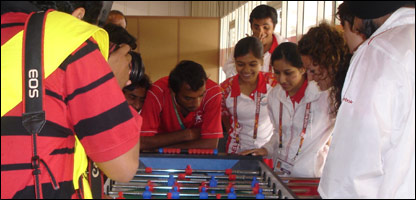 Some of Pakistan's hocky team playing table football with England hockey stars Ashleigh Ball and Sally Walton