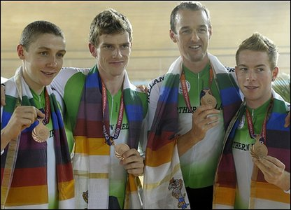 Members of the Northern Ireland team pose with their bronze medals after the  team pursuit cycling event.