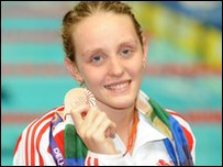 Fran Halsall celebrates with her Bronze 100m freestyle medal