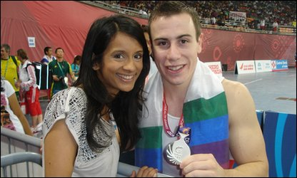 Sonali with British gymnast Luke Folwell and his silver medal at the Commonwealth Games, in Delhi, India