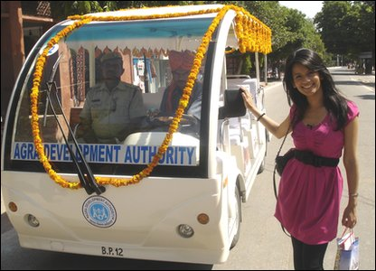Sonali off to the Taj Mahal on this battery-operated vehicle.