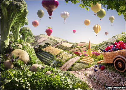 Fields and hot air balloons made out of fruit and vegetables.