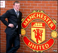 Wayne Rooney posing by Manchester United's club badge when he first signed for the side in September 2004