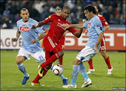 Liverpool's David Ngog (Middle) fights for the ball with Napoli's Hassan Yebda (Left) and Salvatore Aronica (Right)