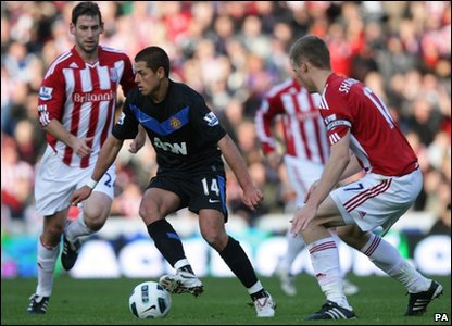 Manchester United's Javier Hernandez turning away from Stoke City's Ryan Shawcross (right) and Rory Delap during the Premier League match at the Britannia Stadium, Stoke on Trent