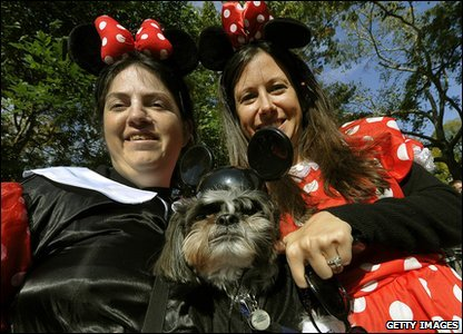Dog and her pals dressed up as Minnie Mouse.
