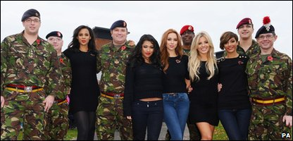 The Saturdays pose with servicemen as they launch the Poppy Appeal