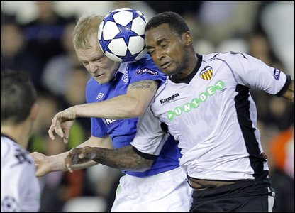 Valencia v Rangers - Steven Naismith heads the ball with Valencia's Miguel Brito