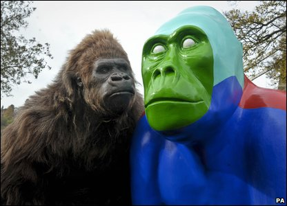 An animatronics gorilla posing next to a sculpture to launch celebrations for Bristol Zoo's 175th birthday.
