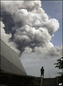 A man watches Mount Merapi erupt