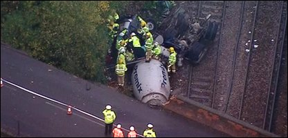 Lorry that fell onto a train at Oxshott in Surrey