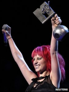 Singer Hayley Williams of Paramore celebrates winning the award for best alternative at the MTV Europe Music Awards 2010 in Madrid