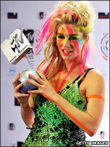 Ke$ha poses with her Best New Act Award at the MTV Europe Music Awards 2010 in Madrid