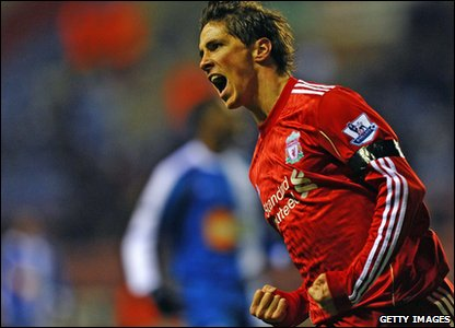 Fernando Torres celebrates after scoring Liverpool's only goal in their Wigan match. But it wasn't enough to secure a win. The Reds were held to a 1-all draw.