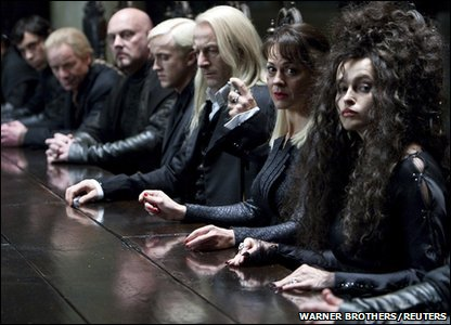 Helena Bonham Carter, Suzie Toase, Jason Isaacs, Tom Felton playing Bellatrix Lestrange, Alecto Carrow, Lucius Malfoy and Draco Malfoy in a scene from Harry Potter and the Deathly Hallows: Part 1