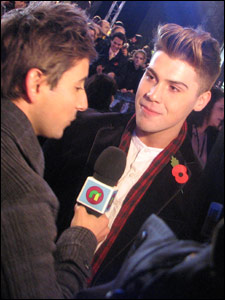 Ricky interviews X Factor contstant Aiden Grimshaw at the world premiere of Harry Potter and the Deathly Hallows, in Leicester Square, London