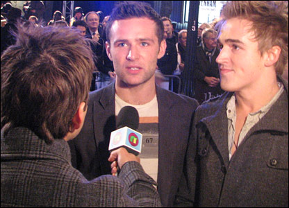 Harry and Tom from McFly chat to Ricky on the red carpet at the world premiere of Harry Potter and the Deathly Hallows, in Leicester Square, London