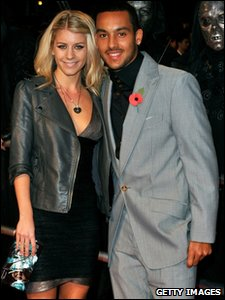 Arsenal footballer Theo Walcott and his girlfriend Melanie Slade on the red carpet at the world premiere of Harry Potter and the Deathly Hallows, in Leicester Square, London